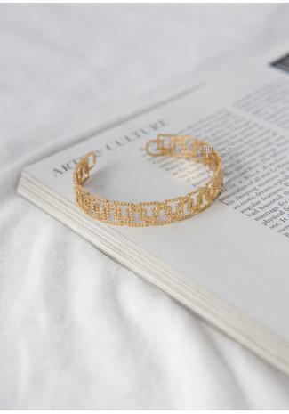 Bracelet jonc doré effet quadrillé