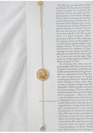 Bracelet doré avec pendentif pièce