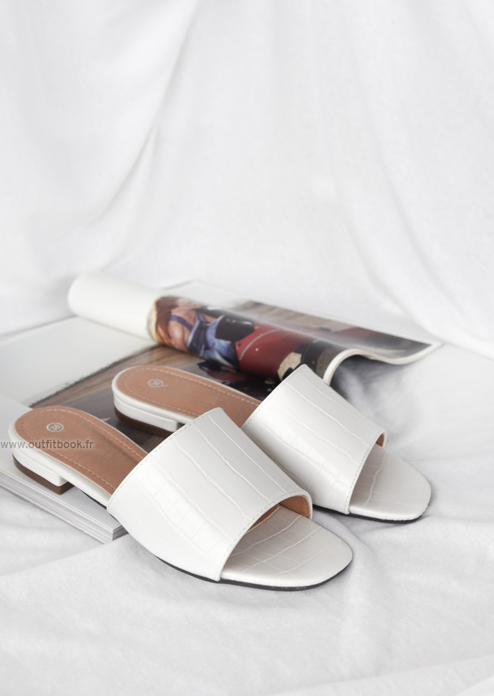 Flat white mules with faux croco