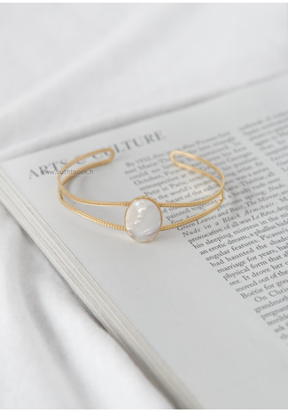 Gold tone cuff bracelet with white stone