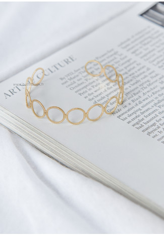 Cuff bracelet with circles in gold tone