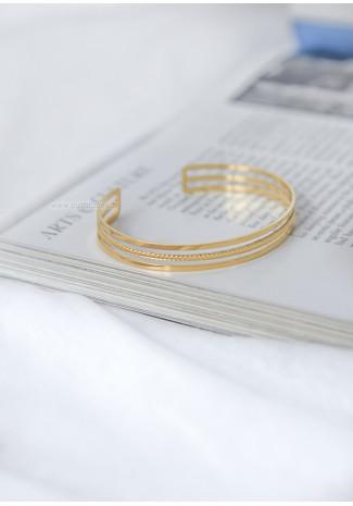 Openwork gold tone cuff bracelet