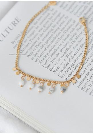 Bracelet chaîne dorée avec petite perles effet marbre