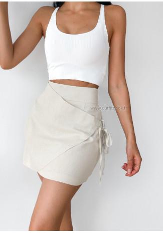 Jupe courte beige effet drapée