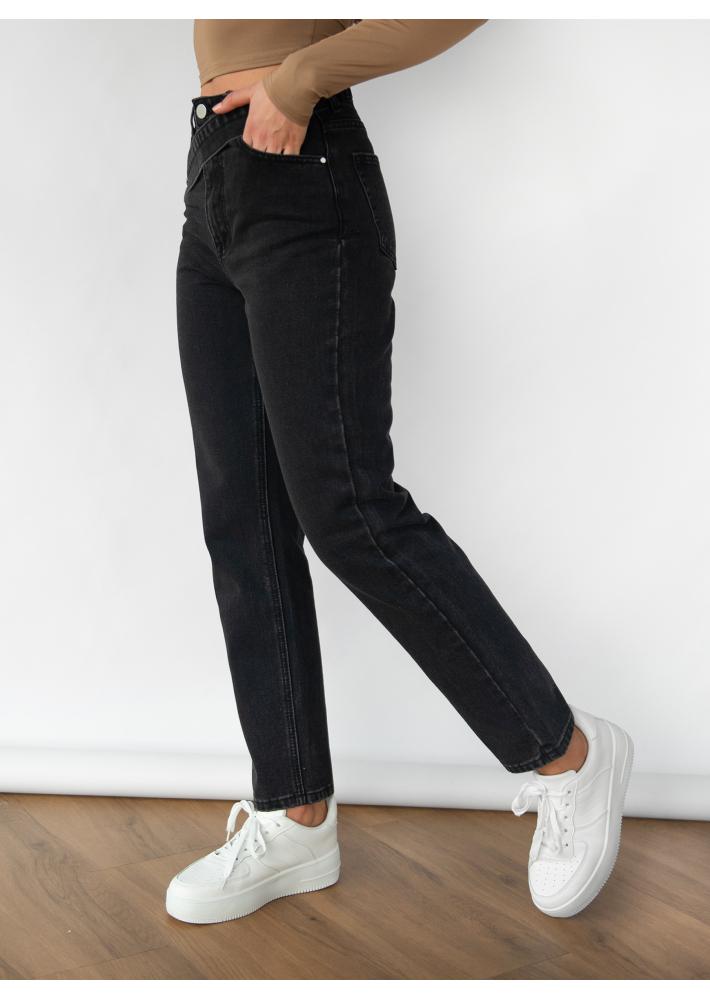 Jeans con cinturilla asimétrica en negro