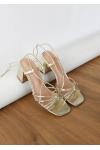 Tie leg mid heeled sandals in gold
