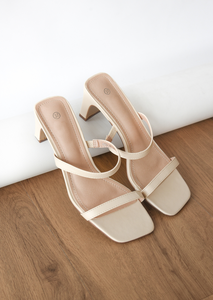 Strappy heeled mules in beige