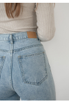 Straight leg jeans with raw hem in light blue