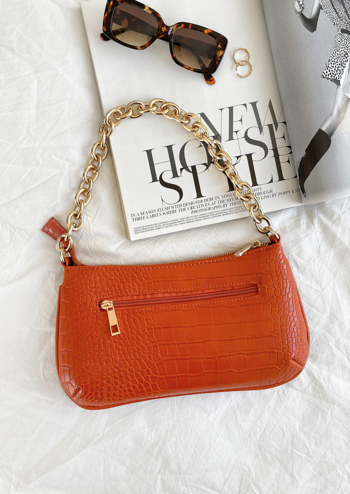 Croc shoulder bag with chunky gold chain in orange