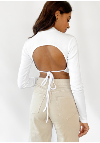 Open back long sleeve top with scarf hem in white