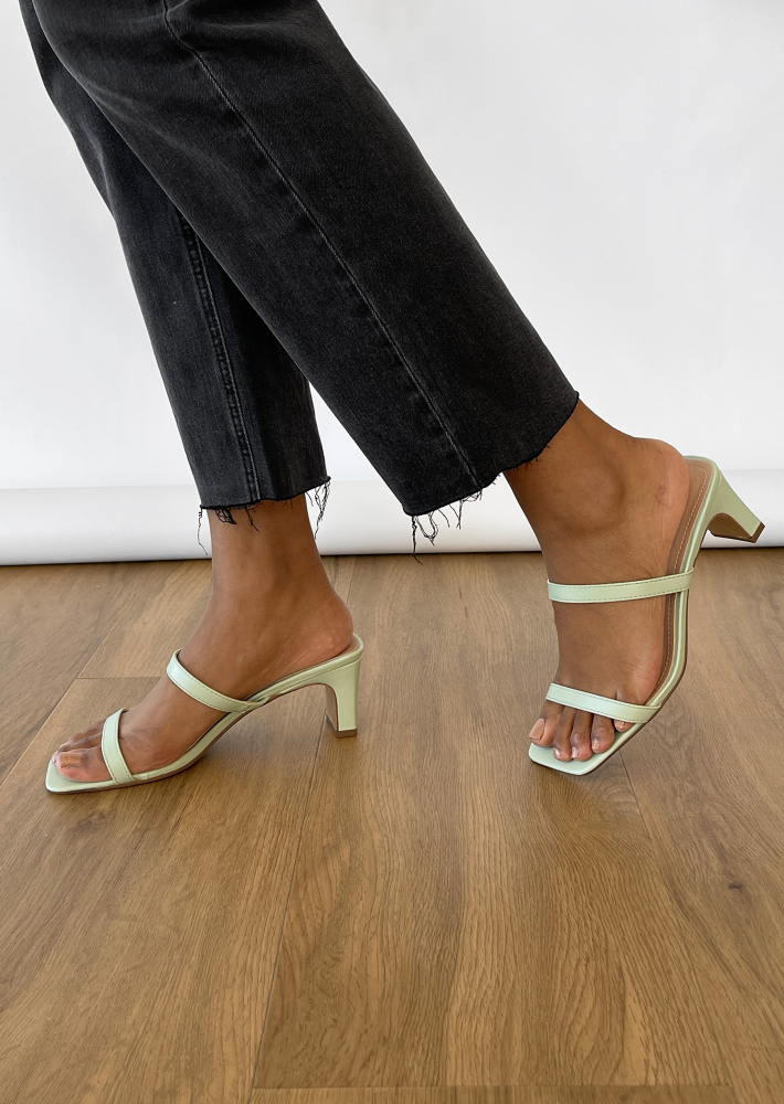 Strappy heeled mules in pastel green