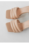 Quilted mules in beige
