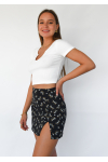 Black floral mini skirt with front split and buttons details