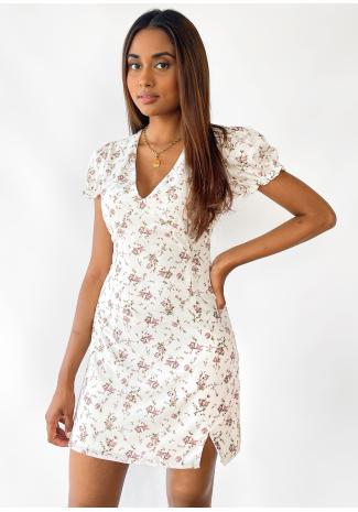 Vestido blanco estampado floral con abertura