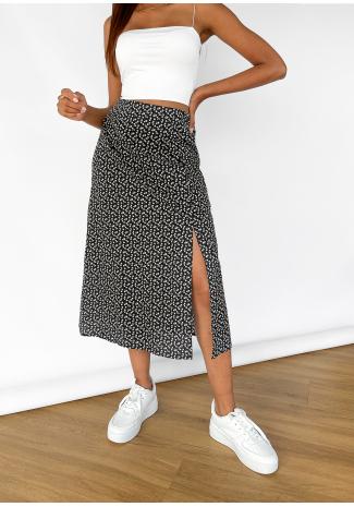Falda midi con abertura y estampado floral en negro